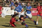 In this handout image provided by the APO Group, Namibia substitute eighthman PJ van Lill on the attack against Tunisia during the Rugby World Cup qualifier and Rugby Africa World Cup match between Namibia and Tunisia at Hage Geingob Rugby Stadium on June 23, 2018 in Windhoek, Namibia.