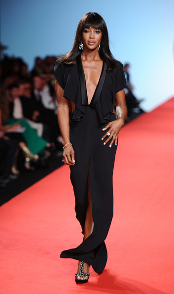 Naomi Campbell Model Naomi Campbell walks the runway at the Fashion For Relief at Forville market during the 64th Annual Cannes Film Festival on May 16, 2011 in Cannes, France.