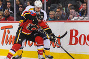 T.J. Galiardi #39 of the Calgary Flames battles for the puck against Michael Del Zotto #5 of the Nashville Predators during an NHL game at Scotiabank Saddledome on March 21, 2014 in Calgary, Alberta, Canada. The Predators defeated the Flames 6-5.