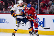 Cody McLeod #55 of the Nashville Predators and Andrei Markov #79 of the Montreal Canadiens battle one another during the NHL game at the Bell Centre on March 2, 2017 in Montreal, Quebec, Canada.