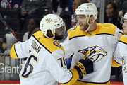 Mattias Ekholm #14 of the Nashville Predators (r) celebrates his goal at 16:46 of the first period against the New York Islanders and is joined by P.K. Subban #76 (l) at the Barclays Center on October 06, 2018 in the Brooklyn borough of New York City.