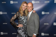 Tracie Hamilton of J/P HRO and figure skater Scott Hamilton attend Nashville Shines for Haiti benefiting Sean Penn's J/P Haitian relief organization featuring Tim McGraw hosted and underwritten by Johnathon Arndt and Newman Arndt at the Arndt Estate on October 24, 2017 in Brentwood, Tennessee.