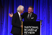 Roger Deakins accepts the award for Outstanding Achievement in Cinematography for 1917 from Daniel Craig onstage during The National Board of Review Annual Awards Gala at Cipriani 42nd Street on January 08, 2020 in New York City.