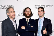 Ronald Bronstein, Josh Safdie, and Benny Safdie pose with an award during The National Board of Review Annual Awards Gala at Cipriani 42nd Street on January 08, 2020 in New York City.