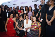 """Eva Longoria (C) and a group of domestic workers arrive at the National Domestic Workers Alliance Celebrates """"ROMA"""" event at The Jane Club on February 24, 2019 in Los Angeles, California."""