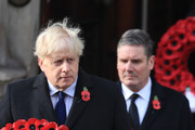 Britain's Prime Minister Boris Johnson (L) and Britain's main opposition Labour Party leader Keir Starmer (R) carry wreaths as they attend a National Service of Remembrance at the Cenotaph in Westminster, amid the spread of coronavirus (COVID-19) disease on November 8, 2020 in London, England. Remembrance Sunday services are still able to go ahead despite the covid-19 measures in place across the various nations of the UK. Each country has issued guidelines to ensure the safety of those taking part.