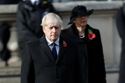 Britain's former Prime Minister Theresa May (R) stands behind Prime Minister Boris Johnson (L) during the National Service Of Remembrance at the Cenotaph in Westminster, amid the spread of coronavirus (COVID-19) disease on November 8, 2020 in London, England. Remembrance Sunday services are still able to go ahead despite the covid-19 measures in place across the various nations of the UK. Each country has issued guidelines to ensure the safety of those taking part.