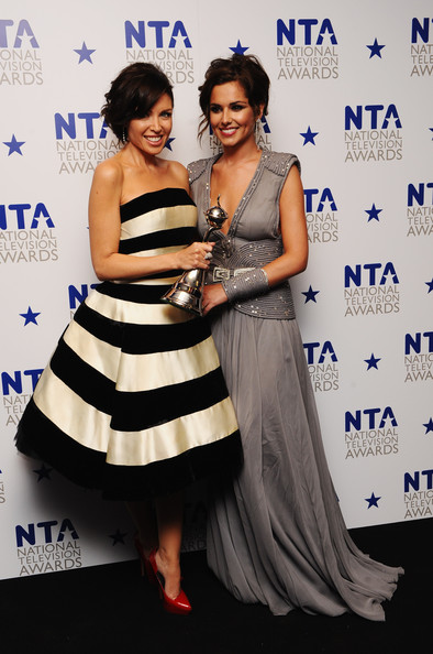 (L-R) X Factor judges Danni Minogue and Cheryl Cole appear with their award for Most Popular Talent Show at the National Television Awards held at O2 Arena on January 20, 2010 in London, England.