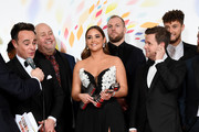 """Anthony McPartlin, Jacqueline Jossa and Declan Donnelly accepting the The Bruce Forsyth Entertainment Award for """"I'm A Celebrity... Get Me Out Of Here!"""", pose in the winners room during the National Television Awards 2020 at The O2 Arena on January 28, 2020 in London, England."""