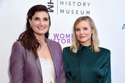 Idina Menzel (L) and Kristen Bell attend National Women's History Museum's 7th Annual Women Making History Awards at The Beverly Hilton Hotel on September 15, 2018 in Beverly Hills, California.