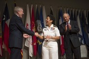In this handout photo provided by the U.S. Navy, Secretary of the Navy Ray Mabus (L) congratulates Adm. Michelle Howard after putting on her fourth star during her promotion ceremony at the Women in Military Service for America Memorial on July 1, 2014 in Washington, D.C. Howard is the first woman to be promoted to the rank of admiral in the history of the Navy and will assume the duties and responsibilities as the 38th Vice Chief of Naval Operations from Adm. Mark Ferguson.
