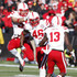 Will Compton Photos - Linebacker Will Compton #51, defensive end Eric Martin #46 and safety P.J. Smith #13 of the Nebraska Cornhuskers celebrate during the fourth quarter after forcing a turnover from the Iowa Hawkeyes on November 23, 2012 at Kinnick Stadium in Iowa City, Iowa. Nebraska defeated Iowa 13-7. - Nebraska v Iowa
