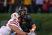 Trevor Siemian #13 of the Northwestern Wildcats fumbles the ball as he is sacked by Jack Gangwish #95 (L) and Kevin Williams #92 of the Nebraska Cornhuskers of the Nebraska Cornhuskers at Ryan Field on October 18, 2014 in Evanston, Illinois. Nebraska defeated Northwestern 38-17.