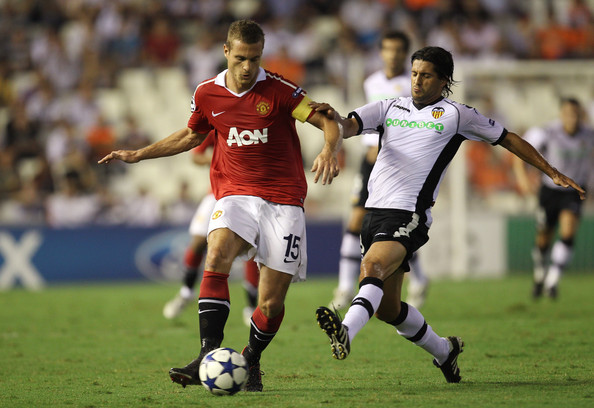 Nemanja Vidic Nemanja Vidic of Manchester United holds off a challenge from Alejandro Dominguez of Valencia during the UEFA Champions League Group C match between Valencia and Manchester United at the Mestalla Stadium on September 29, 2010 in Valencia, Spain.