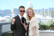 "Director Nicolas Winding Refn and actress Elle Fanning attend ""The Neon Demon"" Photocall during the 69th annual Cannes Film Festival at the Palais des Festivals on May 20, 2016 in Cannes, France."