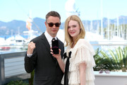 "Elle Fanning (R) and director Nicolas Winding Refn attend the ""The Neon Demon"" photocall during the 69th annual Cannes Film Festival at Palais des Festivals on May 20, 2016 in Cannes, France."