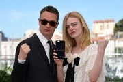"Danish director Nicolas Winding Refn (L) and US actress Elle Fanning pose on May 20, 2016 during a photocall for the film ""The Neon Demon"" at the 69th Cannes Film Festival in Cannes, southern France.  / AFP / ANNE-CHRISTINE POUJOULAT"