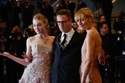 "Danish director Nicolas Winding Refn (C) poses with his wife Liv Corfixen (R) and US actress Elle Fanning as they arrive on May 20, 2016 for the screening of the film ""The Neon Demon"" at the 69th Cannes Film Festival in Cannes, southern France. / AFP / ALBERTO PIZZOLI"