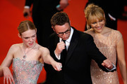 """Director Nicolas Winding Refn (C), Liv Corixen (R) and actress Elle Fanning (L) attend """"The Neon Demon"""" Premiere during the 69th annual Cannes Film Festival at the Palais des Festivals on May 20, 2016 in Cannes, France."""