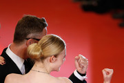 """Director Nicolas Winding Refn (L) and actress Elle Fanning (L) attend """"The Neon Demon"""" Premiere during the 69th annual Cannes Film Festival at the Palais des Festivals on May 20, 2016 in Cannes, France."""
