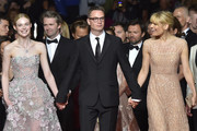 "Danish director Nicolas Winding Refn (C) arrives with his wife Liv Corfixen (R) and US actress Elle Fanning on May 20, 2016 for the screening of the film ""The Neon Demon"" at the 69th Cannes Film Festival in Cannes, southern France.  / AFP / LOIC VENANCE"