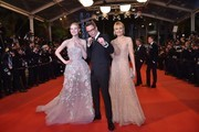 "Danish director Nicolas Winding Refn (C) poses with his wife Liv Corfixen (R) and US actress Elle Fanning as they arrive on May 20, 2016 for the screening of the film ""The Neon Demon"" at the 69th Cannes Film Festival in Cannes, southern France.  / AFP / LOIC VENANCE"