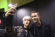 (LR)An EXO member and Ryan Reynolds attend the world premiere of Netflix's '6 Underground' at Dongdaemun Design Plaza on December 02, 2019 in Seoul, South Korea.