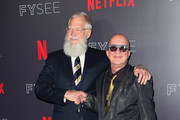 "TV host David Letterman (L) and musical director pose at the Netflix #FYSEE ""My Next Guest Needs No Introduction With David Letterman"" FYC Event at Netflix FYSEE at Raleigh Studios on May 7, 2018 in Los Angeles, California."