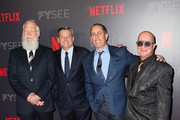 "(L-R) TV host David Letterman, Chief Content Officer for Netflix Ted Sarandos, comedian Jerry Seinfeld and musical director Paul Shaffer pose at the Netflix #FYSEE ""My Next Guest Needs No Introduction With David Letterman"" FYC Event at Netflix FYSEE at Raleigh Studios on May 7, 2018 in Los Angeles, California."