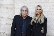 """Enrico Vanzina and Martina Stella attend a photocall for the Netflix Original Movie """"Natale A 5 Stelle"""" at The Space Cinema Moderno on December 4, 2018 in Rome, Italy."""