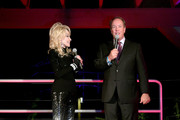 """Dolly Parton and Craig Ross speak onstage during the Netflix Premiere of Dolly Parton's """"Heartstrings"""" on October 29, 2019 in Pigeon Forge, Tennessee."""