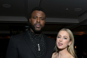 (L-R) Winston Duke and Iliza Shlesinger attend the Netflix Premiere Spenser Confidential After Party at Westwood Village Theatre on February 27, 2020 in Westwood, California.