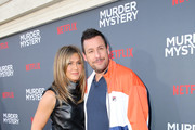 "(L-R) Jennifer Aniston and Adam Sandler attend the Netflix World Premiere Of ""Murder Mystery"" at Village Theatre Westwood on June 10, 2019 in Los Angeles, California."