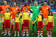 (L-R) Ron Vlaar, Daley Blind, Bruno Martins Indi, Jasper Cillessen and Robin van Persie of the Netherlands look on with their player escorts during the National Anthem prior to the 2014 FIFA World Cup Brazil Semi Final match between the Netherlands and Argentina at Arena de Sao Paulo on July 9, 2014 in Sao Paulo, Brazil.