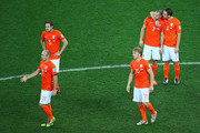 Arjen Robben, Daley Blind, Dirk Kuyt, Ron Vlaar and Stefan de Vrij of the Netherlands look dejected after being defeated by Argentina in a penalty shootout during the 2014 FIFA World Cup Brazil Semi Final match between the Netherlands and Argentina at Arena de Sao Paulo on July 9, 2014 in Sao Paulo, Brazil.