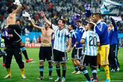 Lionel Messi of Argentina celebrates with teammates after defeating the Netherlands in a penalty shootout during the 2014 FIFA World Cup Brazil Semi Final match between the Netherlands and Argentina at Arena de Sao Paulo on July 9, 2014 in Sao Paulo, Brazil.