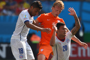 Gonzalo Jara and Charles Aranguiz of Chile challenge Dirk Kuyt of the Netherlands during the 2014 FIFA World Cup Brazil Group B match between the Netherlands and Chile at Arena de Sao Paulo on June 23, 2014 in Sao Paulo, Brazil.
