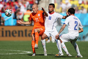 Arjen Robben of the Netherlands controls the ball as Gonzalo Jara and Eugenio Mena of Chile give chase during the 2014 FIFA World Cup Brazil Group B match between the Netherlands and Chile at Arena de Sao Paulo on June 23, 2014 in Sao Paulo, Brazil.