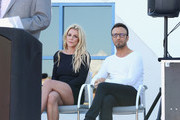 Singer Britney Spears (L) and talent manager Larry Rudolph listen to Clark County Commissioner Steve Sisolak's speech during the grand opening of the Nevada Childhood Cancer Foundation Britney Spears Campus on November 4, 2017 in Las Vegas, Nevada.