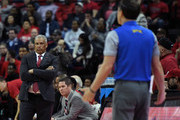 Head coach Marvin Menzies (L) of the UNLV Rebels looks at head coach Eric Musselman of the Nevada Wolf Pack as he yells to officials about not getting a foul call during their game against the UNLV Rebels at the Thomas & Mack Center on February 28, 2018 in Las Vegas, Nevada. The Wolf Pack won 101-75.