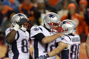 Danny Amendola #80 of the New England Patriots is congratulated by Dwayne Allen #83 and Tom Brady #12 after scoring a touchdown against the Denver Broncos at Sports Authority Field at Mile High on November 13, 2017 in Denver, Colorado.