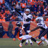 Tom Brady Photos - Quarterback Tom Brady #12 of the New England Patriots passes against the Denver Broncos in the second quarter of a game at Sports Authority Field at Mile High on December 18, 2016 in Denver, Colorado. - New England Patriots v Denver Broncos