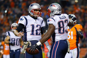 Tight end Dwayne Allen #83 of the New England Patriots celebrates with Tom Brady #12 after scoring a second quarter touchdown against the Denver Broncos at Sports Authority Field at Mile High on November 12, 2017 in Denver, Colorado.