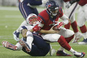 Brian Hoyer #7 of the Houston Texans fumbles the ball while being sacked by Jabaal Sheard #93 of the New England Patriots in the fourth quarter on December 13, 2015 at NRG Stadium in Houston, Texas.