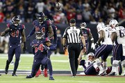 Jake Martin #54 of the Houston Texans reacts after a defensive stop against Tom Brady #12 of the New England Patriots during the second quarter in the game at NRG Stadium on December 01, 2019 in Houston, Texas.