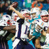 Tom Brady Photos - Tom Brady #12 of the New England Patriots passes under pressure in the fourth quarter against the Miami Dolphins at Hard Rock Stadium on December 11, 2017 in Miami Gardens, Florida. - New England Patriots v Miami Dolphins