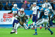 Dion Lewis #33 of the New England Patriots tries to avoid the tackle from Chase Allen #59 of the Miami Dolphins during the second quarter at Hard Rock Stadium on December 11, 2017 in Miami Gardens, Florida.
