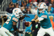 Jay Cutler #6 of the Miami Dolphins hands off to  Kenyan Drake #32 in the third quarter against the New England Patriots at Hard Rock Stadium on December 11, 2017 in Miami Gardens, Florida.