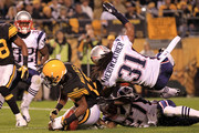 Mike Wallace #17 of the Pittsburgh Steelers drops the ball in the endzone under pressure from Brandon Meriweather #31 and Kyle Arrington #27 of the New England Patriots on November 14, 2010 at Heinz Field in Pittsburgh, Pennsylvania.
