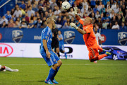 Matt Reis #1 of the New England Revolution jumps to stop the ball on a cross pass intended for Marco Di Vaio #9 of the Montreal Impact during the MLS match at the Saputo Stadium on July 18, 2012 in Montreal, Quebec, Canada.  The Impact defeated the Revolution 2-1.